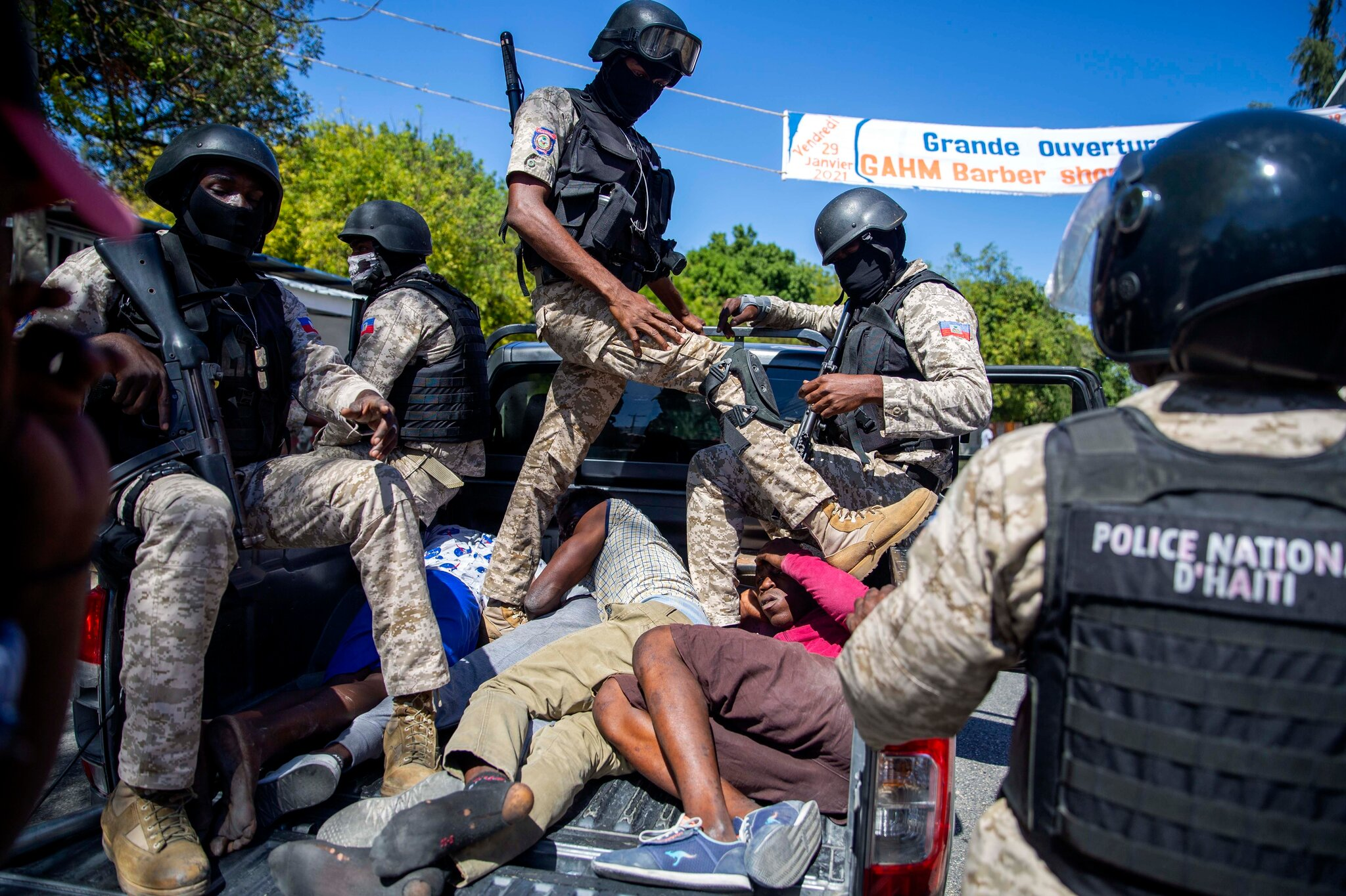 Officers intervene during a demonstration calling for president Jovenel Moïse's resignation